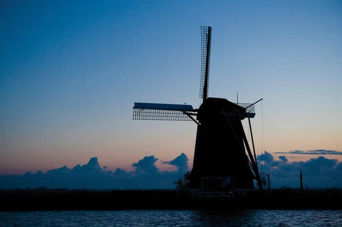 Holland Windmill - Our Dutch treat is perfect for the novice cyclist with miles of quiet country roads, mostly very flat. You can enjoy seeing Holland while either riding on dedicated bike trails or the comfort of your movable hotel: our boat, which moves along the many canals of the Netherlands.