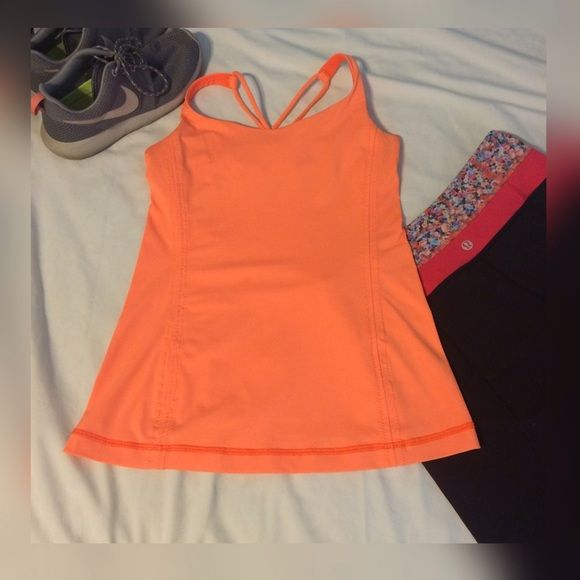 Free to beLululemon athletica tank Cute orange Free to be lululemon tank tag has been ripped out, but is a 4:) great condition with no piling or stains! No inserts❤️ please ask questions!❤️ lululemon athletica Tops