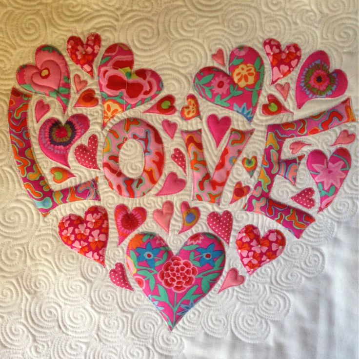 LOVEheart, shown in progress, by Laura Lobb at Laura in Stitches.   Kaffe Fassett fabrics.