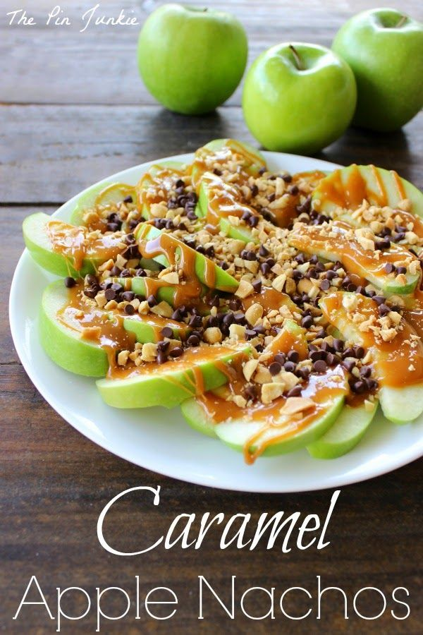 Caramel Apple Nachos 2 apples ( green Granny Smith, cored and sliced ) 5 ounces caramels ( candies ) 1 teaspoon water 1/4 cup peanuts ( chopped ) 2 tablespoons mini chocolate chips