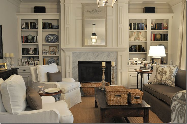 Family room design by Joni Webb, Cote de Texas  Pretty neutrals/woodwork/awful surround
