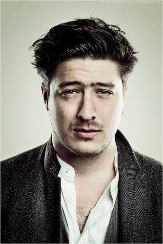 """A lot of the time it feels like… music is some sort of excuse to be a human. It's kind of like people need that excuse to go and put their arms in the air and sing their hearts out."" - Marcus Mumford"
