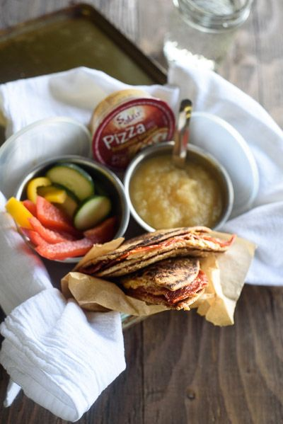 These easy pizza hummus sammies are the perfect easy lunch box idea! We smashed up a grilled cheese and pizza into a healthier version that kids love.