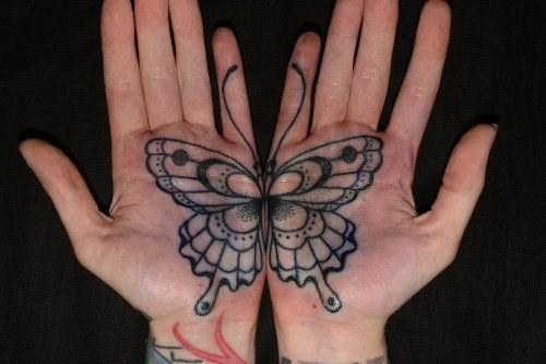 Butterfly palm tattoo