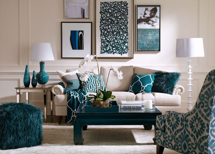white couch allows art and peacock blue and teal accents to pop - Blue Beige Living Room Ideas