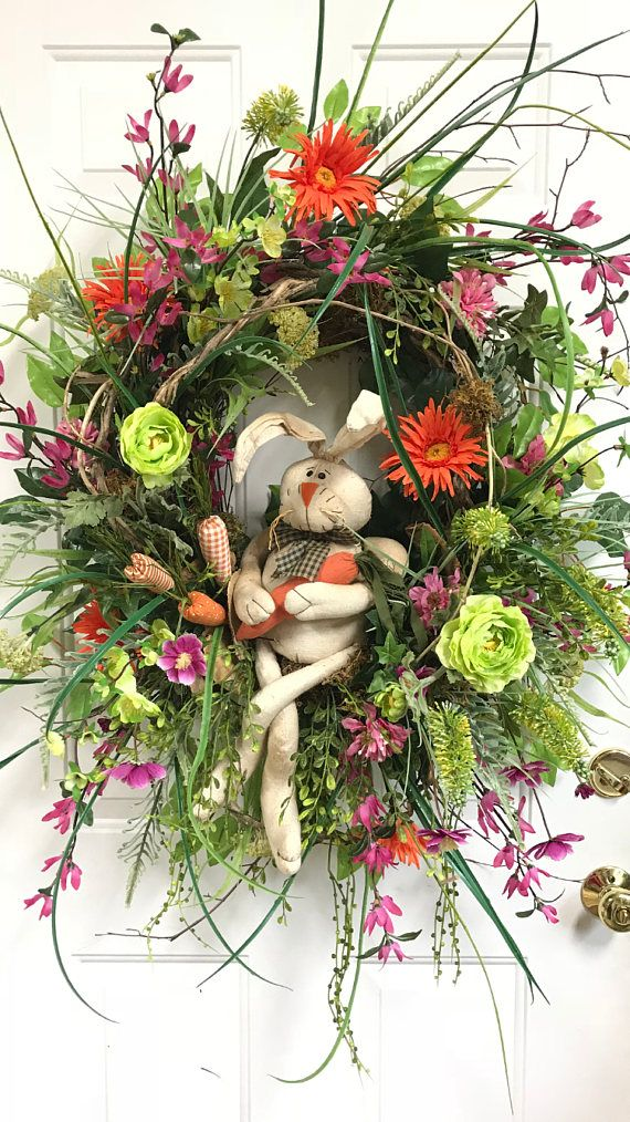 This beautiful, spring, outdoor wreath, which is made on one of our exclusive wild birch bases, will look so sweet hanging on your front door for the spring season and even Easter! If you love bunnies...this is a must have! :) The airy sticks which radiate out are one thing that