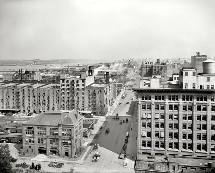 "New York circa 1912. ""West Street (11th Avenue) north from 26th, view of Hudson River."" As well as the Chelsea Piers and fluttering banner atop the Otis Elevator building."