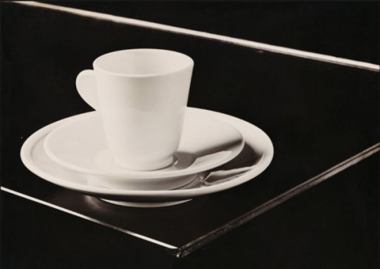 """Hans Finsler, cup and saucer of the """"Hermes service"""", 1931. Designed by Marguerite Friedländer for an airport restaurant. Gelatin silver print. Berlin. Via Staedel Museum"""