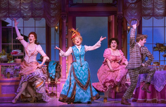 "An antic ""Hello, Dolly!"" ensemble, from left: Kate Baldwin as Irene Molloy, Bette Midler as Dolly Gallagher Levi, Beanie Feldstein as Minnie Fay and Taylor Trensch as Barnaby Tucker. Credit Sara Krulwich/The New York Times"