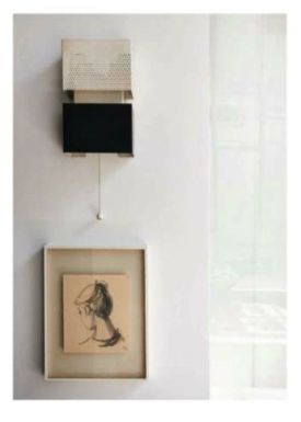 """A pull-cord wall light by Jacques Biny and a portrait of Charlotte Gainsbourg by Ruben Alterio.  The February 2014 issue of """"The World of Interiors"""" Magazine features a great article on Charlotte Gainsbourg and Yvan Attal's apartement in Paris. Have a look, it's gorgeous! #charlottegainsbourg #yvanattal #florencelopez"""