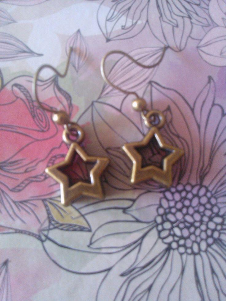 Aretes estrella oro viejo
