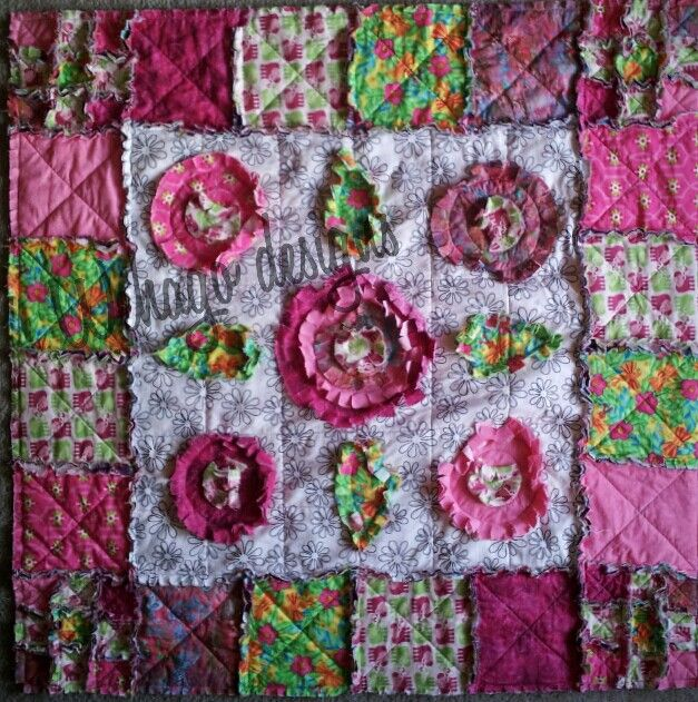 Elephant frolics amongst the flowers quilt.  Pattern available see Wehago designs on Facebook