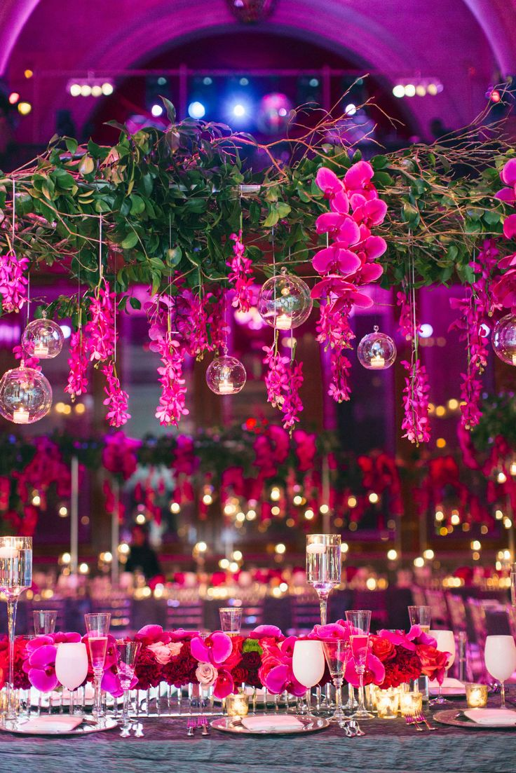 Vibrant Fuchsia Orchid Overhead Arrangement   Photography: Heather Waraksa. Read More: http://www.insideweddings.com/weddings/summer-wedding-with-vibrant-color-palette-in-brooklyn-new-york/738/