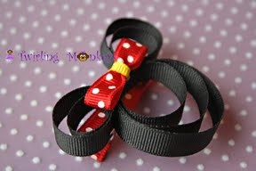 MINNIE! Not only am I a Disney Vacation Specialist who can customize a Disney vacation for you, I also create Disney inspired hair bows! $5+shipping! Contact me at wendy@fairytaleescapes.com for more info!