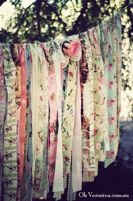 Fabric strips, for a party garland outdoors...between the trees! (and see the silky, pink rose)