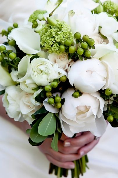 White and green bouquet with peonies, ranunculus, hydrangea and hypericum berry. Designed by Bella Flora 30a.