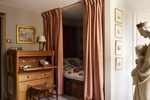 Curtained Bed Alcove in Decorating Ideas for Small Flats & Studio Apartments, small bedroom with patchwork quilt, antique bureau, wooden floor and grey walls.