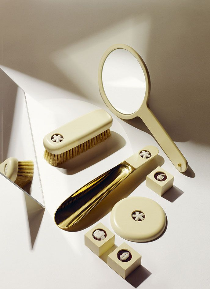 Crafted from brass and avoriolina, an ivory substitute formed from cellulose and pulverised animal bones, this vanity set comprises a shoe horn, hand mirror, pocket mirror and brush, finished with a contemporary cameo of our Wallpaper* asterisk, an eye, a mouth or a silhouette of Studio Irvine's Marialaura Rossiello and Maddalena Casadei. #wallpaperhandmade