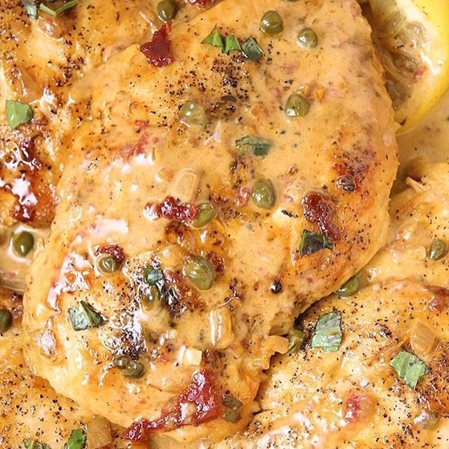 Seared chicken breasts are topped with a lemon garlic butter sauce, sundried tomatoes and capers. This Olive Garden replicate is tangy and semi-sweet from the cream creating one very flavorful chicken dish. A total must try dish even if you've never tried capers. Recipe can be found at alyonascooking.com