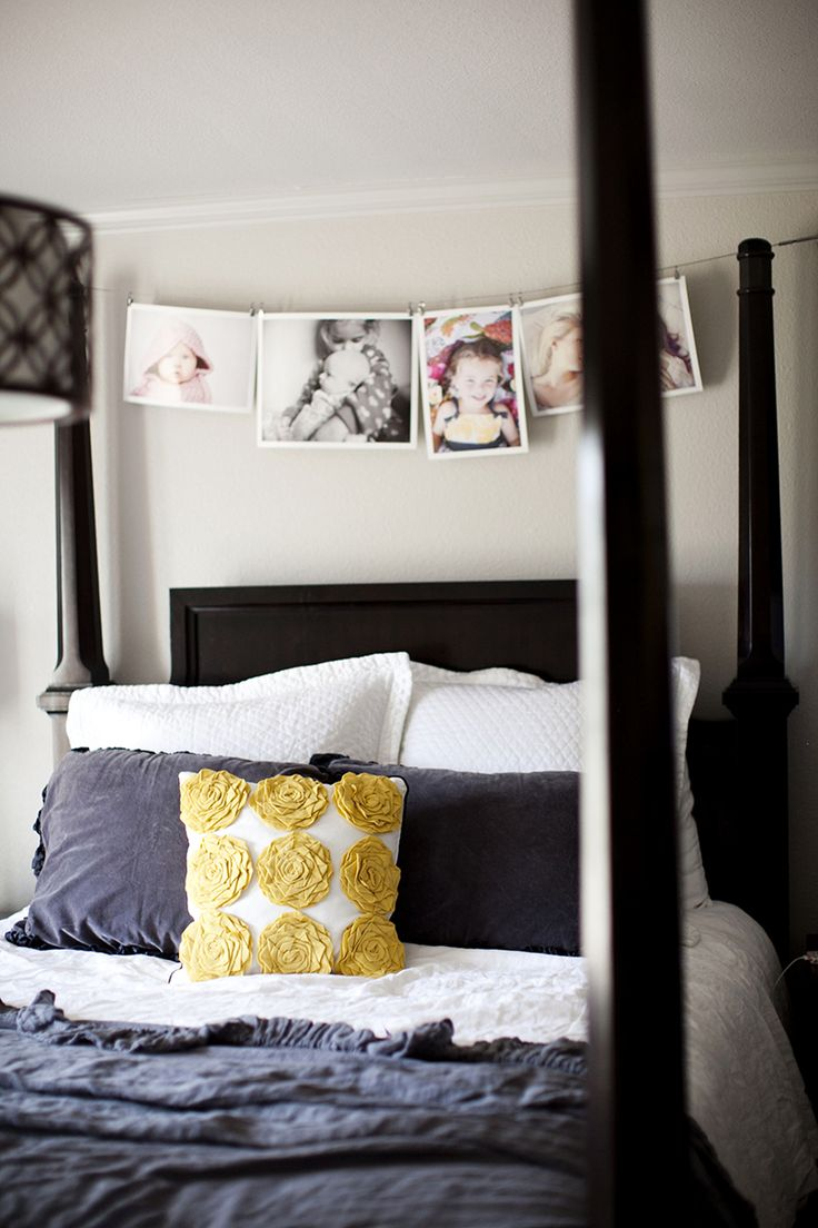 large printed pictures strung up over the headboard- so adorable!!!!