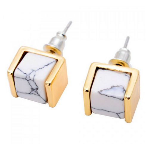 Patricia: These earrings are modern, subtle yet confident. Get these gorgeous studs in silver or gold (or both!)