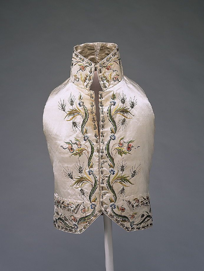 Vest, France, c. 1785. White silk satin with elaborate flower and grain pattern, embroidered in metalic thread and polychrome silks.