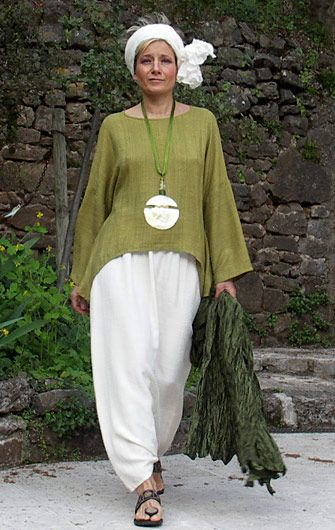 Top unstructured made of raw silk lime green color<br /> harem pants made of mixte white linen.<br /> White silk scarf tied in a turban.<br /> Deep green shawl made of taffeta pure silk<br /> Mother of Pearl necklace patinated with gold leaf