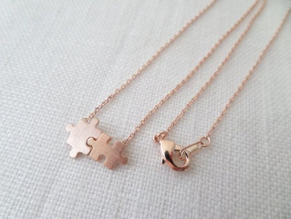 This adorable puzzle piece.   18 Rose Gold Necklaces That Will Take Your Breath Away
