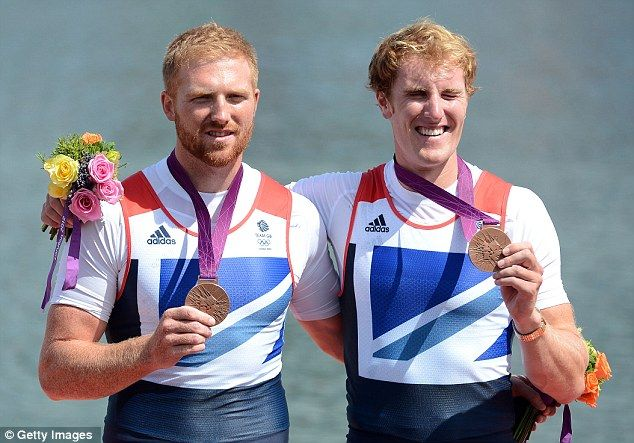 All smiles: William Satch and George Nash show off their bronze medals on the podium
