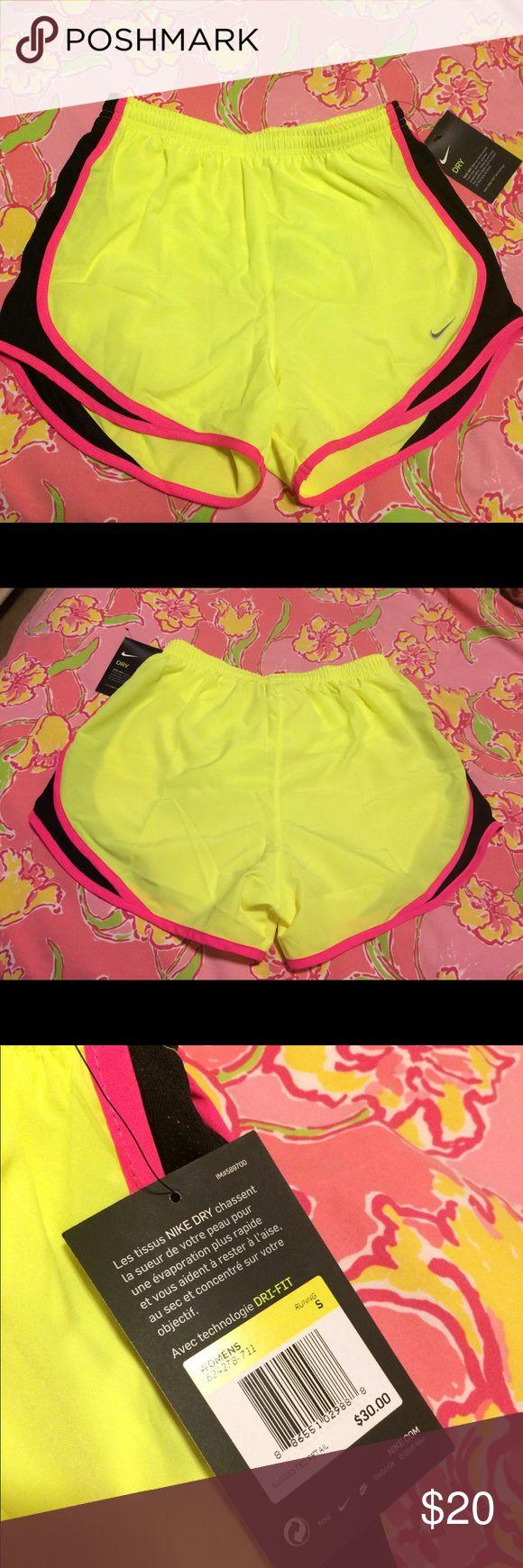 NWT Nike Dri Fit shorts small No trades... new with tags. Nike Dri Fit shorts. Neon yellow with pink & black trim. Size womens small. Nike Shorts