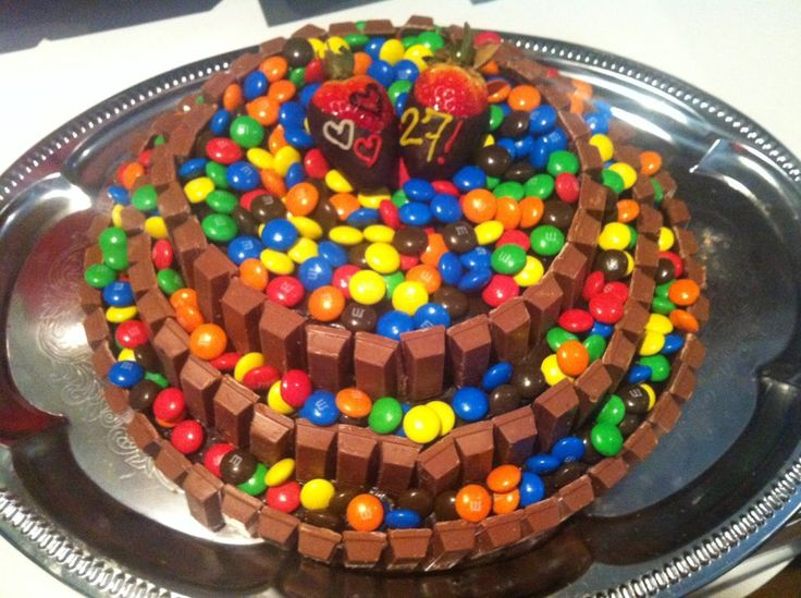 Kit-Kat M&M's cake made for my dearest. It has layer cake under all this chocolately goodness. I cut all small kit-kat's in half and used melted chocolate to get it all to stick. The strawberries where dipped in the same melted chocolate and glacing tubes where used for the text.