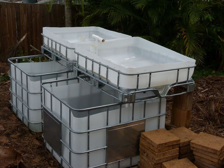 Aquaponics setup from IBC totes.  Find on craigslist for $60 - $100 each. (they sell these down the road from me cheap but they go FAST) I need to do this!: