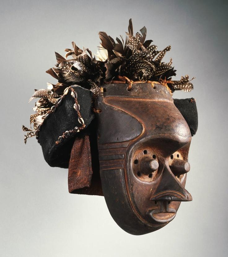 Kuba artist Mask, early 20th century Wood, raffia, shells, and feathers