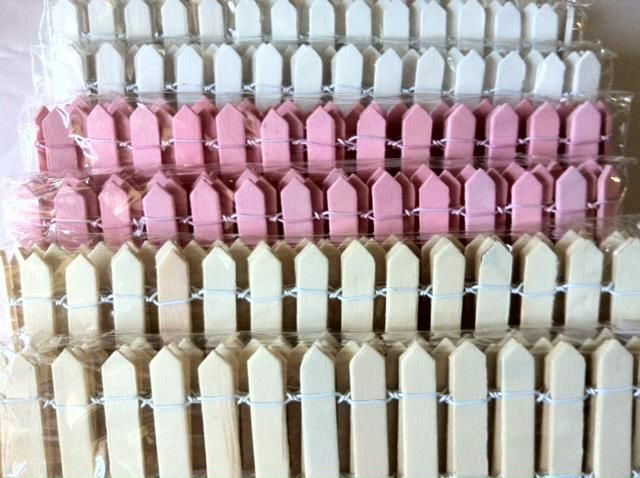 Mini wooden fences - available in white, pink and natural colour. $6.50 each  Size: 5.5 cm H x 1 mt long. Great to wrap around platters or risers.     Fence comes flat and the wire is flexible so they can be bent into a square, or rectangular shape.