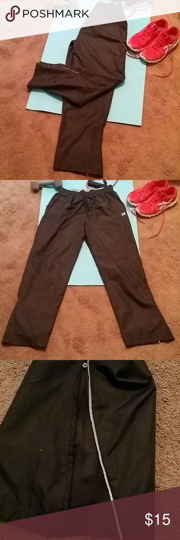 *flash sale*Men's workout pants Black with gray/silver detail at bottom of each pant leg revealing a zipper. Unzipped has a mesh lining. Lightweight pant. 100% polyester. Elastic waist with shoestring type drawstring. Great condition. Pants Sweatpants & Joggers