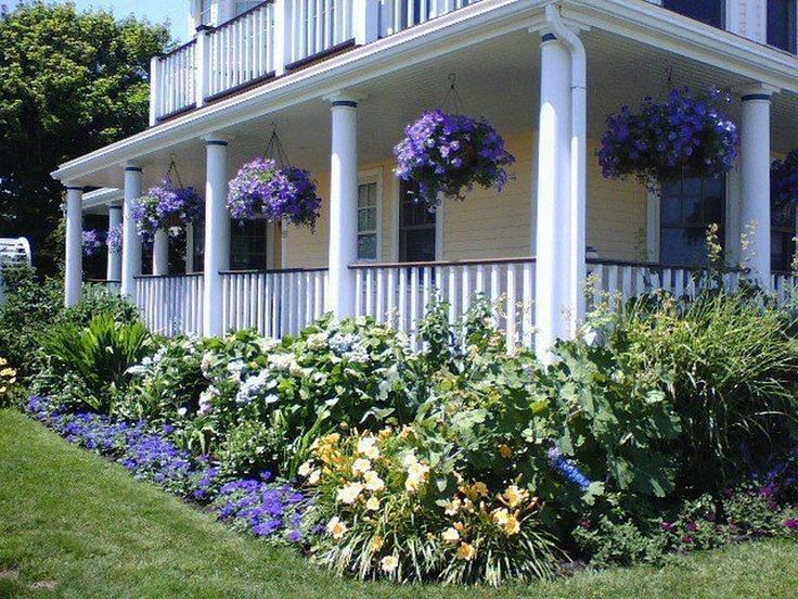 25 best ideas about farmhouse landscaping on pinterest for Front porch landscaping plants