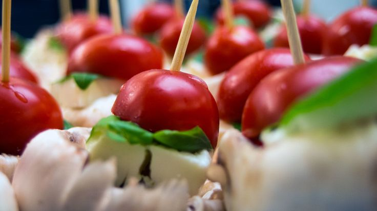 Canapes. Mushrooms, cherry tomatoes, mozzarella and basil leaf.