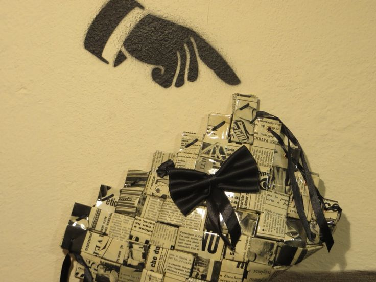 Italian newspapers from the early 50's, reused to create a SoSo Vogue clutch. Check it in our website! www.soprasotto.org