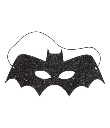 Gold-colored/glittery. Glittery bat-shaped or cat-shaped masks. Elastic at back.