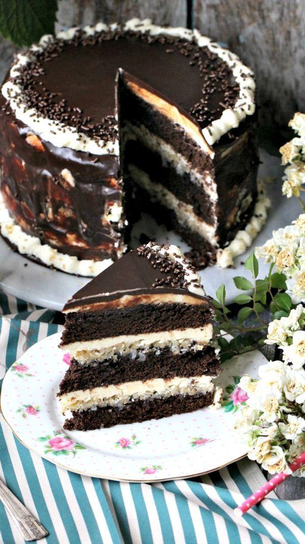 Homemade chocolate brownie cake with layers of vanilla mascarpone buttercream, and coconut walnut custard.