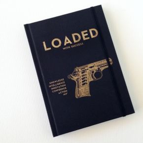 "success loaded 001 notebook #notebooks #Storymood  Our ""SUCCESS LOADED 001"" design is inspired by the most famous of James Bond's 007 handgun the Walther PPK. It is armed with : knowledge, intelligence, innovation, confidence & action! original artwork & concept by Caroline Rovithi (www.carolinerovithi.com)  Hard cover black notebook dimensions : 18 cm x 12,5 cm x 1,5 cm  with 192 white blank pages"