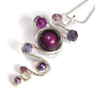 """Handmade Squiggle & Loop Wire Pendant - Purple  £20.00  Handcrafted silver plated (non-tarnish) wire pendant with various purple glass pearls and beads. On a silver plated 16"""" snake chain with a 2"""" extension chain. Please email for other colour options."""