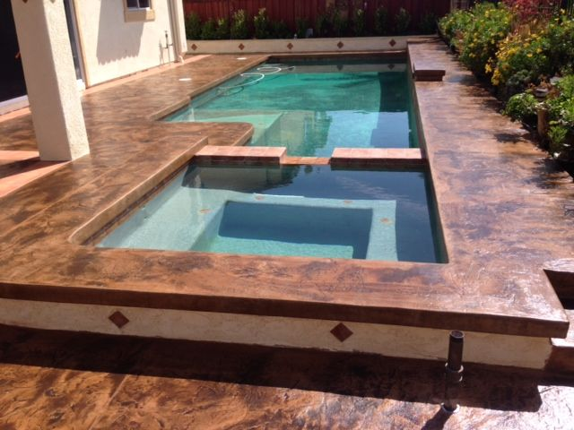 Stamped Pool Deck Made With NewLook Solid Base And Tique Wash By KB Concrete  Staining Company.
