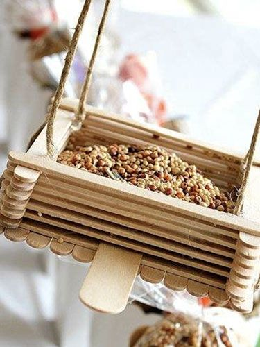 relive summer camp craft hour with this easy feeder you can make with your kids