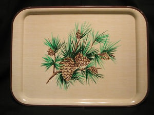 Metal pine cone tray We didn't have the tray, but my mom had a set of dishes w/ this design on them.
