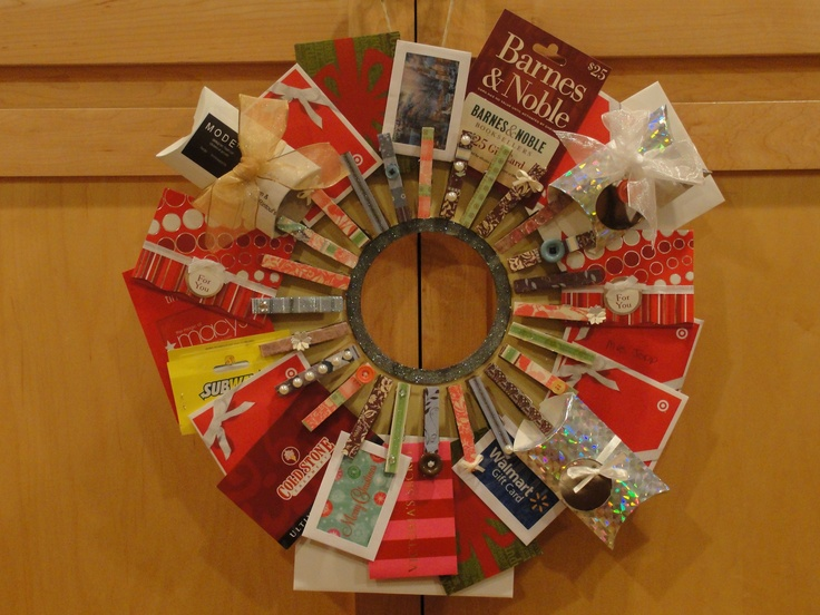 Gift Card Wreath! 25 students, 25 clothes pins, pretty paper, modge podge, & 25 Gift Cards made the perfect teacher Christmas Gift from the class.Christmas Gift