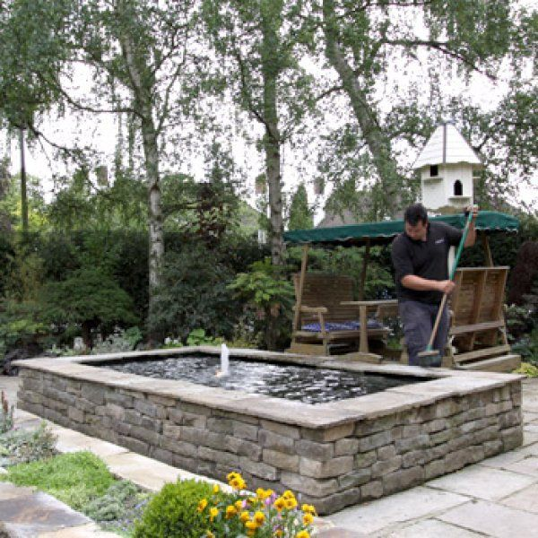 Here 39 s a rectangular raised stacked stone above ground for Backyard fish pond