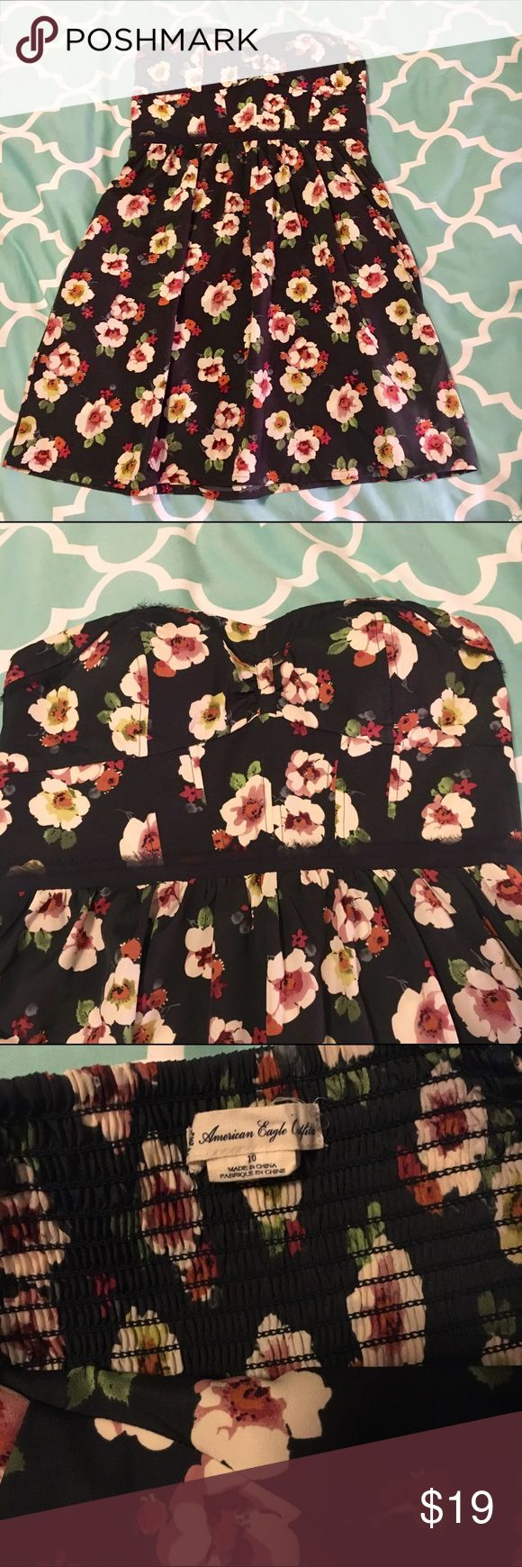 """American Eagle navy floral dress Strapless, sweetheart neckline floral dress. Navy with cream and pink flowers. Has molded padded bust so could be worn without a strapless bra. Pulls on, no zipper. Has pockets. Very flattering and cute! Top of bust to hem, 29"""" American Eagle Outfitters Dresses Strapless"""