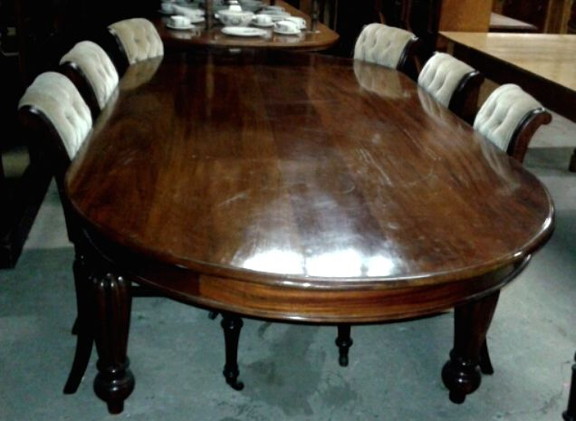 #Sold! Mahogany dining room table and chairs. This is a set of 10 Victorian chairs with sabre back legs and front baluster legs. The table has a D-shaped top with gadrooned craved legs. #DiningRoom #Furniture #Mahogany #Table #Chairs #Victorian