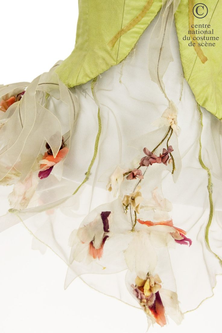 Dance Dress: 1965. Une fleur. Short Tutu. Light green taffeta Bustier adorned with orange and pink flowers on the chest, basque ruffled white horsehair, with applications of leaves and orange and pink flowers. Detail: